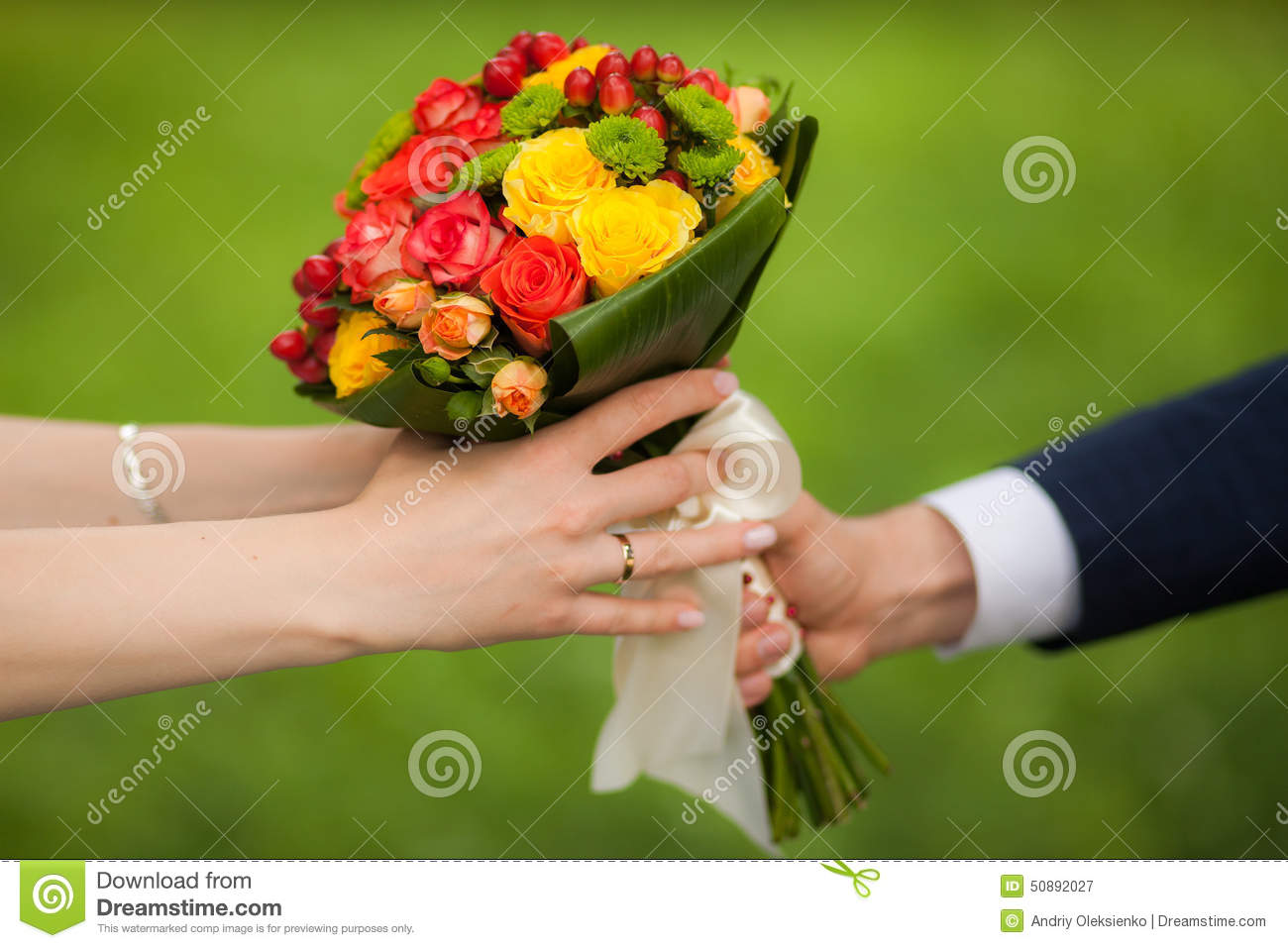 Close up of beautiful bouquet of fresh flowers man and woman hands close up of beautiful bouquet of fresh flowers man and woman hands happy bride groom over summer green park background izmirmasajfo Gallery
