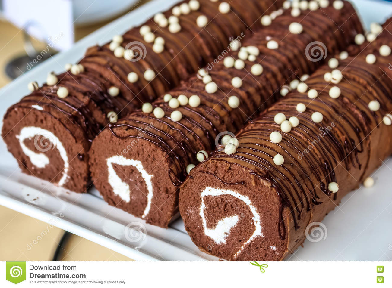 Close Up Beautiful Chocolate Yam Roll In White Plate Stock Photo
