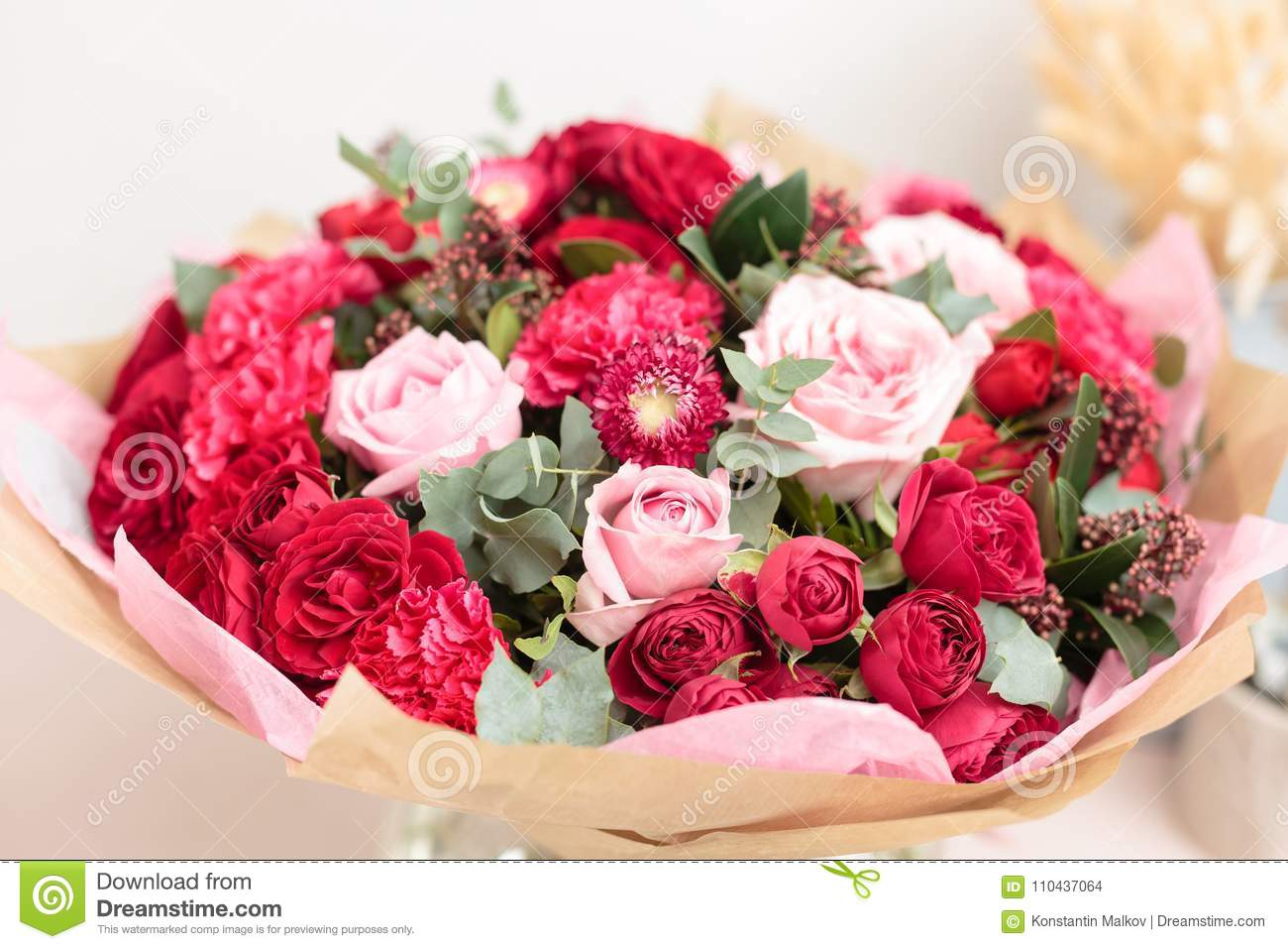 Close up beautiful luxury bouquet of mixed red and pink flowers in royalty free stock photo izmirmasajfo Choice Image