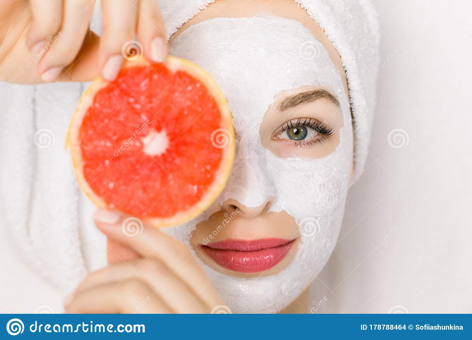 Close Up Of Beautiful Young Smiling Woman With Towel On Head Facial Skin Mask Holding Grapefruit Slice In Front Of Her Stock Photo Image Of Female Apply 178788464