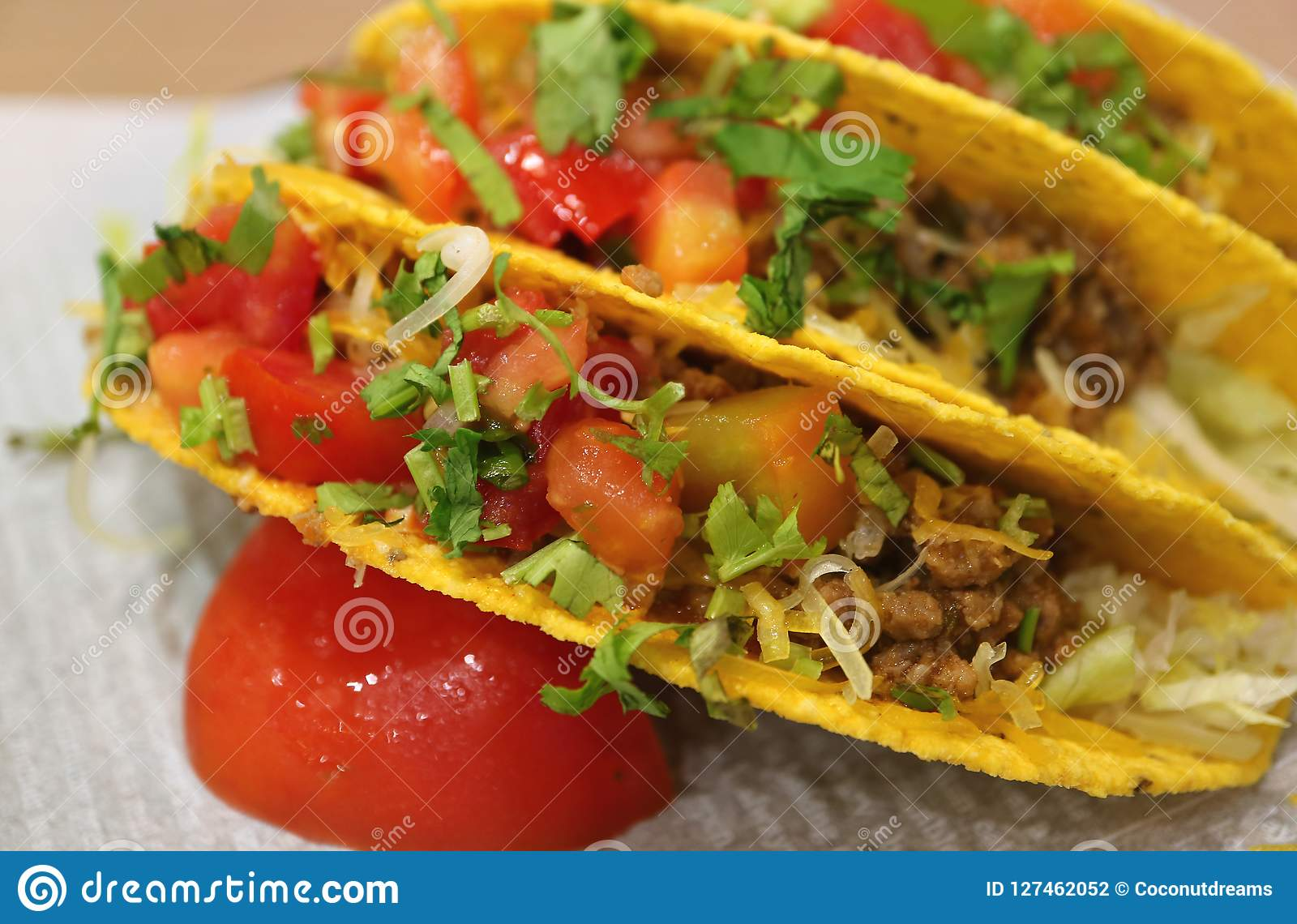 Close up of beef tacos with salsa sauce, tasty Mexican fast food