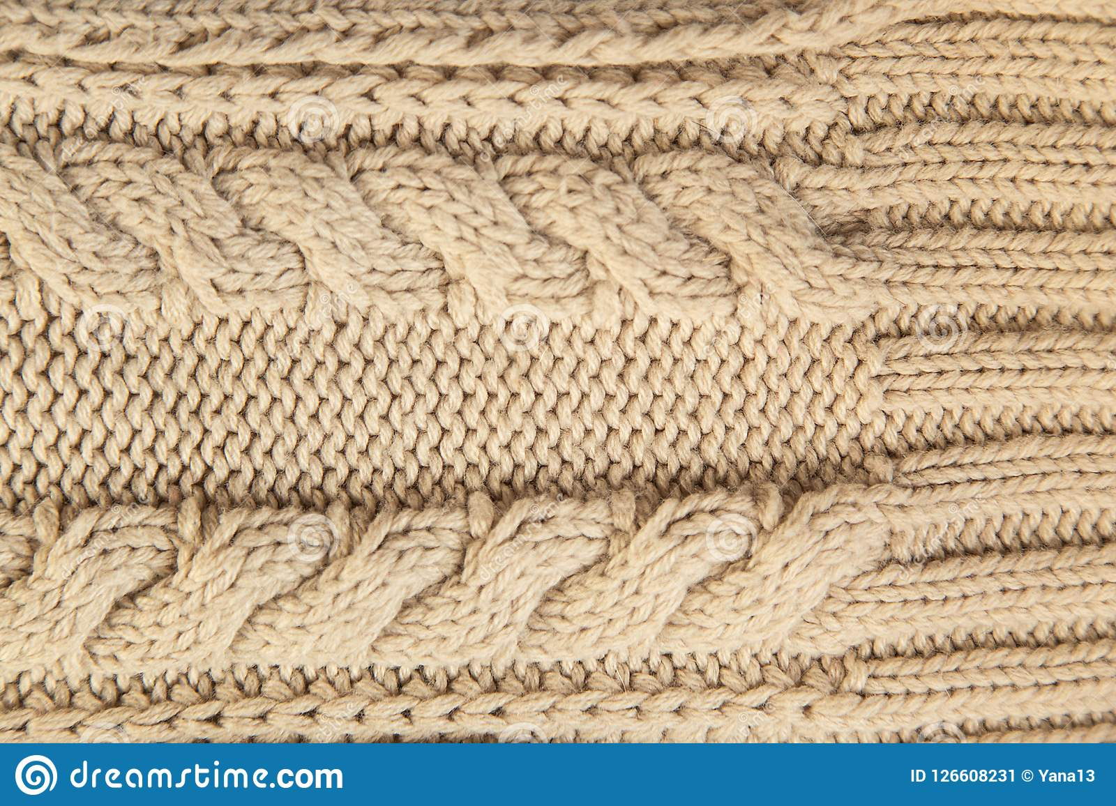 92dde1f30ca3 Close up of beige knitted winter sweater with pattern as textured material  concept