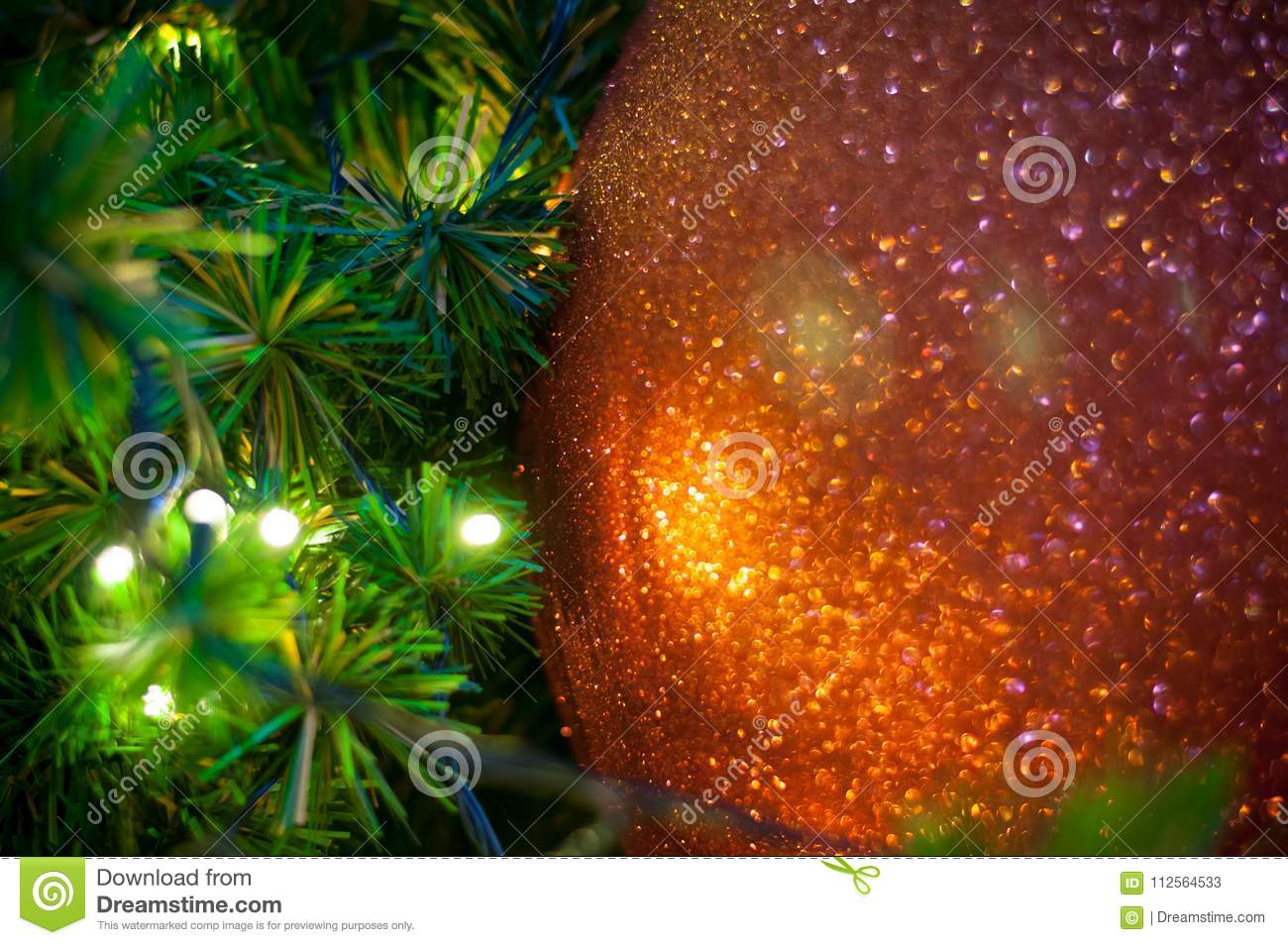 download close up big red glitter ball christmas on tree with wire white light background stock
