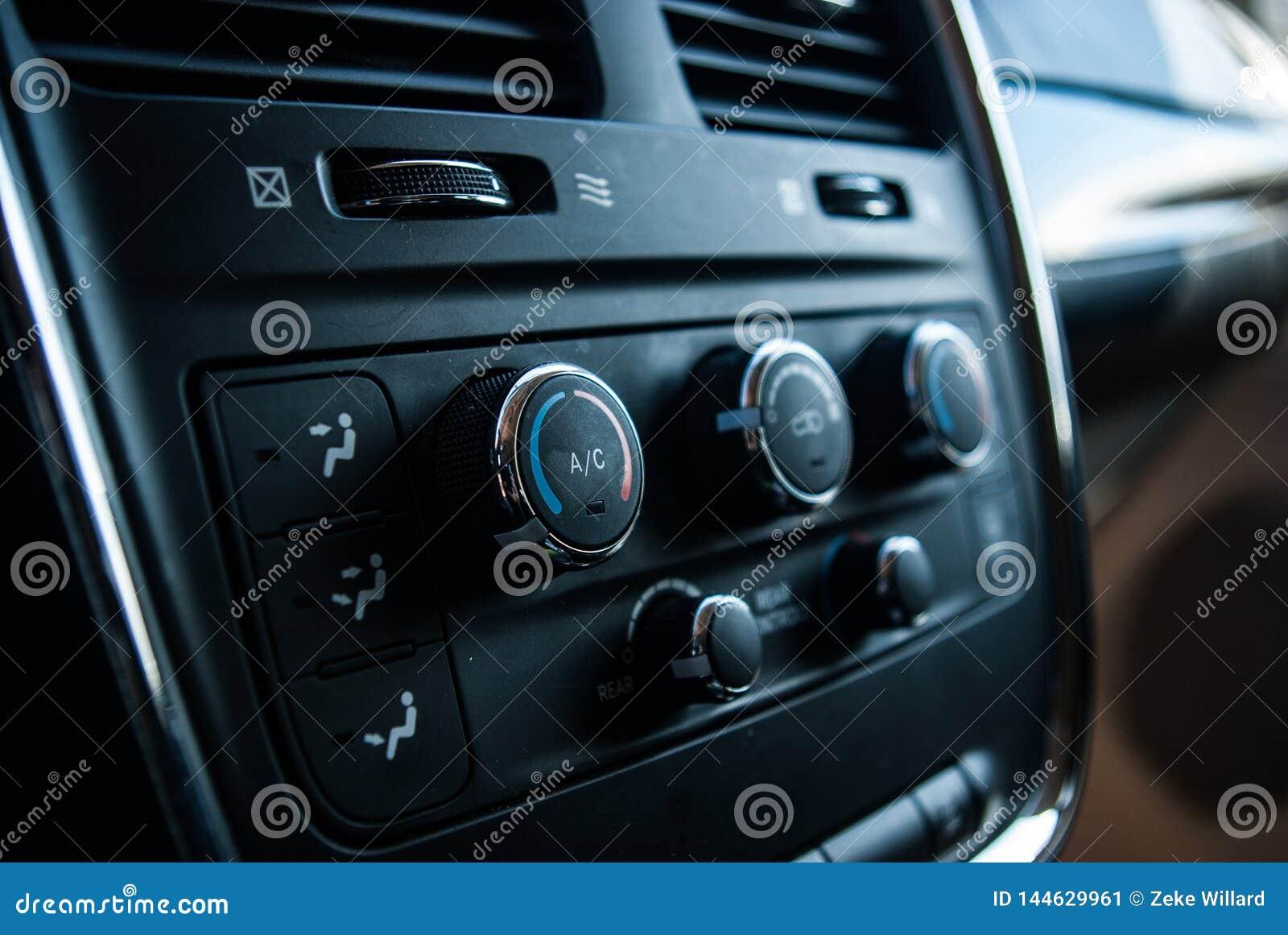 Close up black mini van interior, a/c dials