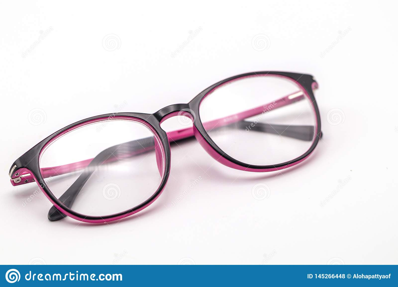 Close up black and pink eye glasses on white background.