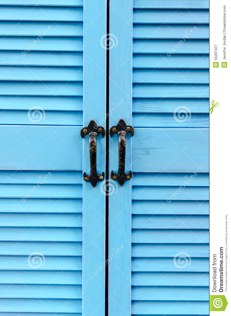 Slatted Doors close up blue slatted doors with black iron handles - vertical