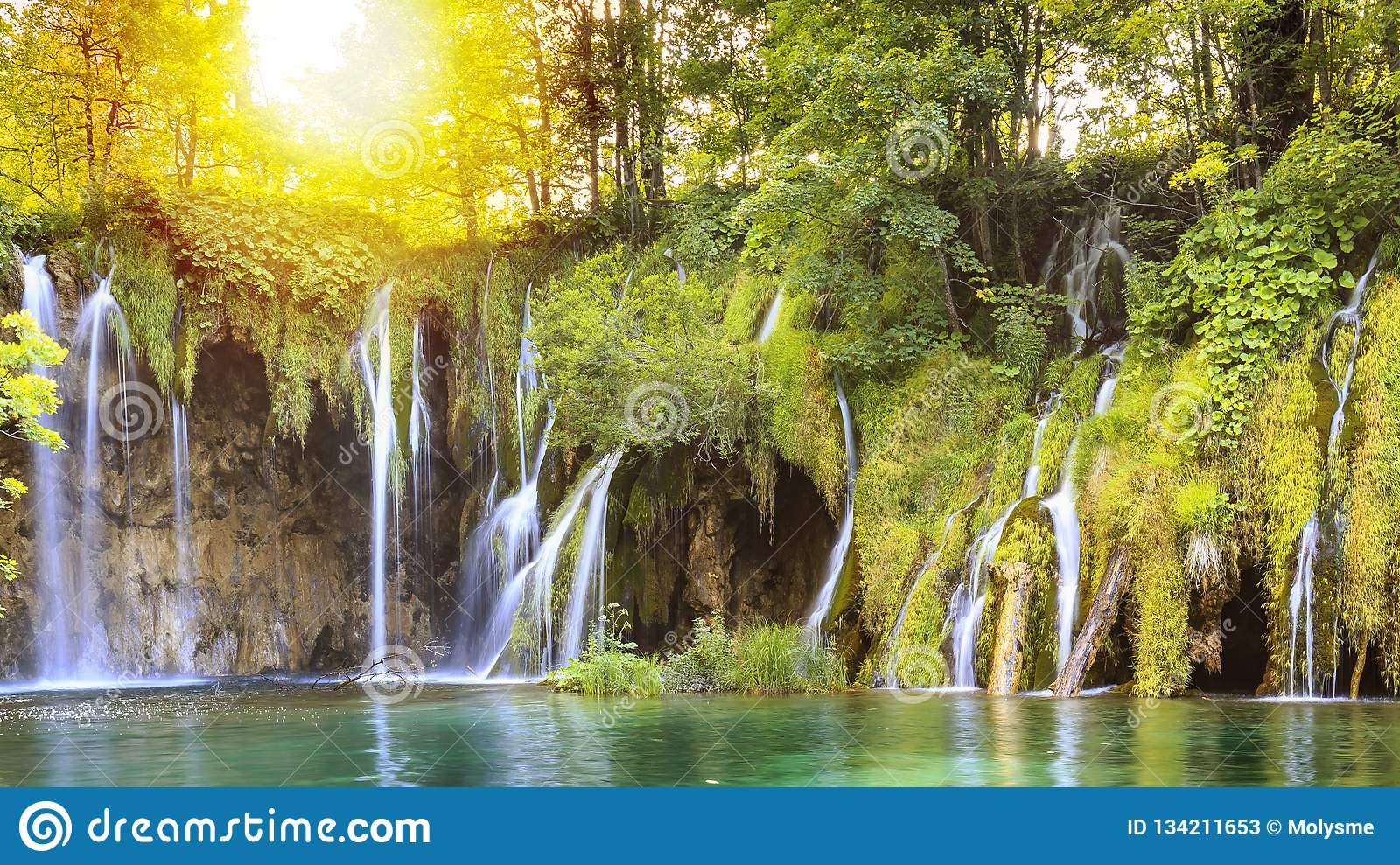 Close up of blue waterfalls in a green forest. Plitvice lakes, Croatia
