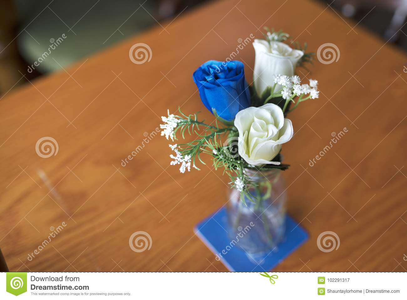 Close Up Of Blue And White Artificial Roses As A Table Decoration In on small clocks cheap, small handbags cheap, small baskets cheap, small trophies cheap, small tables cheap, small chairs cheap, small fish bowls cheap,