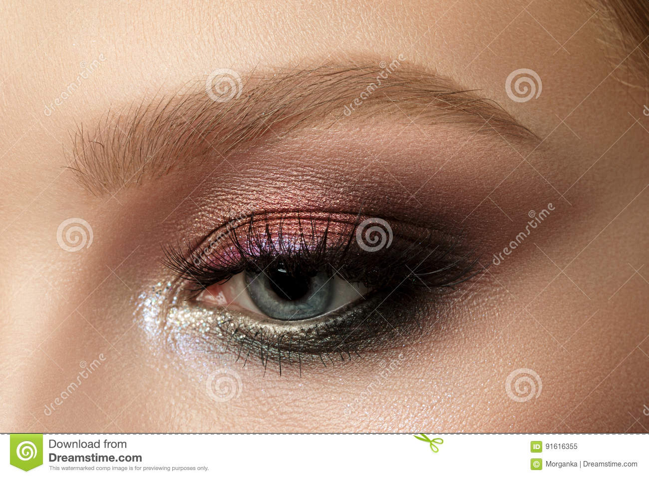 Close Up Of Blue Woman Eye With Smokey Eyes Makeup Stock Image