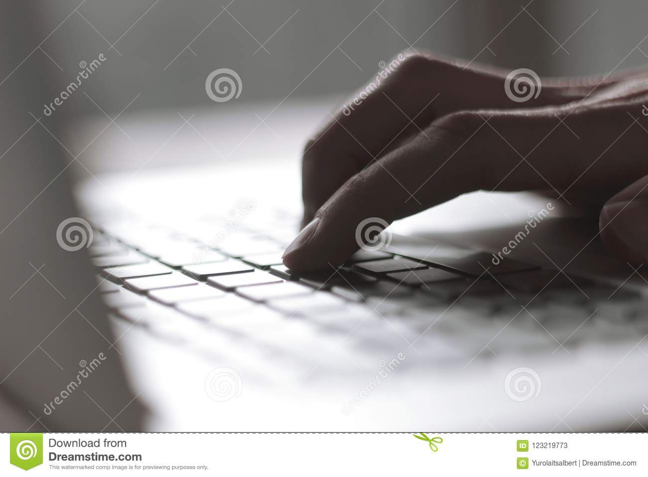 Close up. blurred image of male hand typing on laptop keyboard