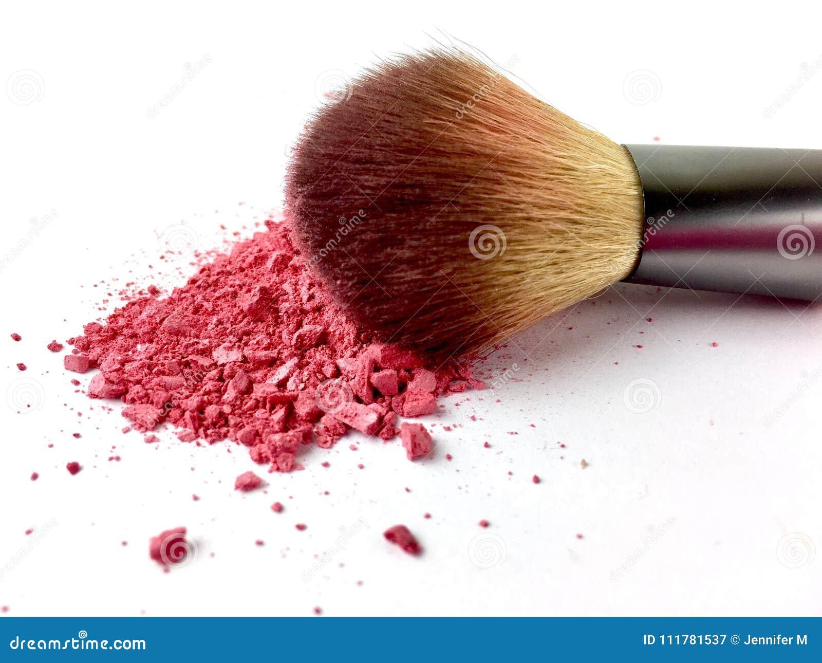 Pink powder and blush brush on a white background