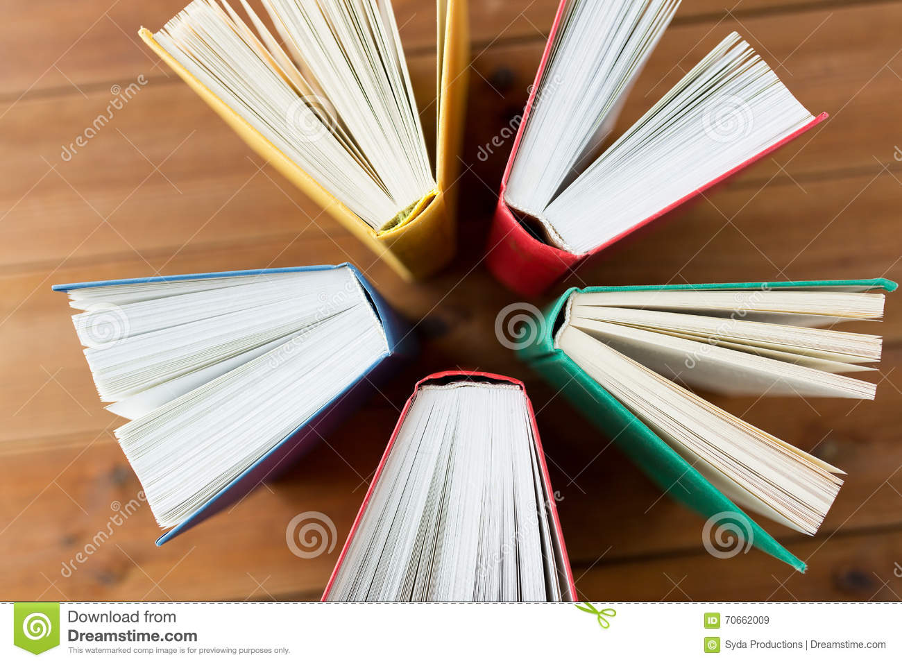 Close up of books on wooden table stock photo