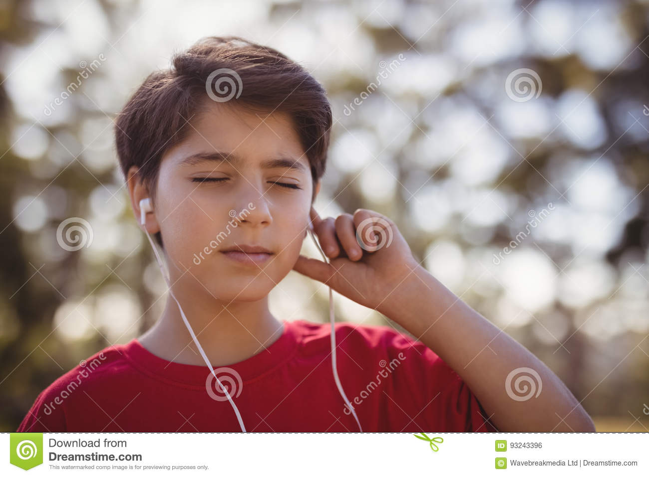 Close-up of boy listening music on headphones during obstacle course