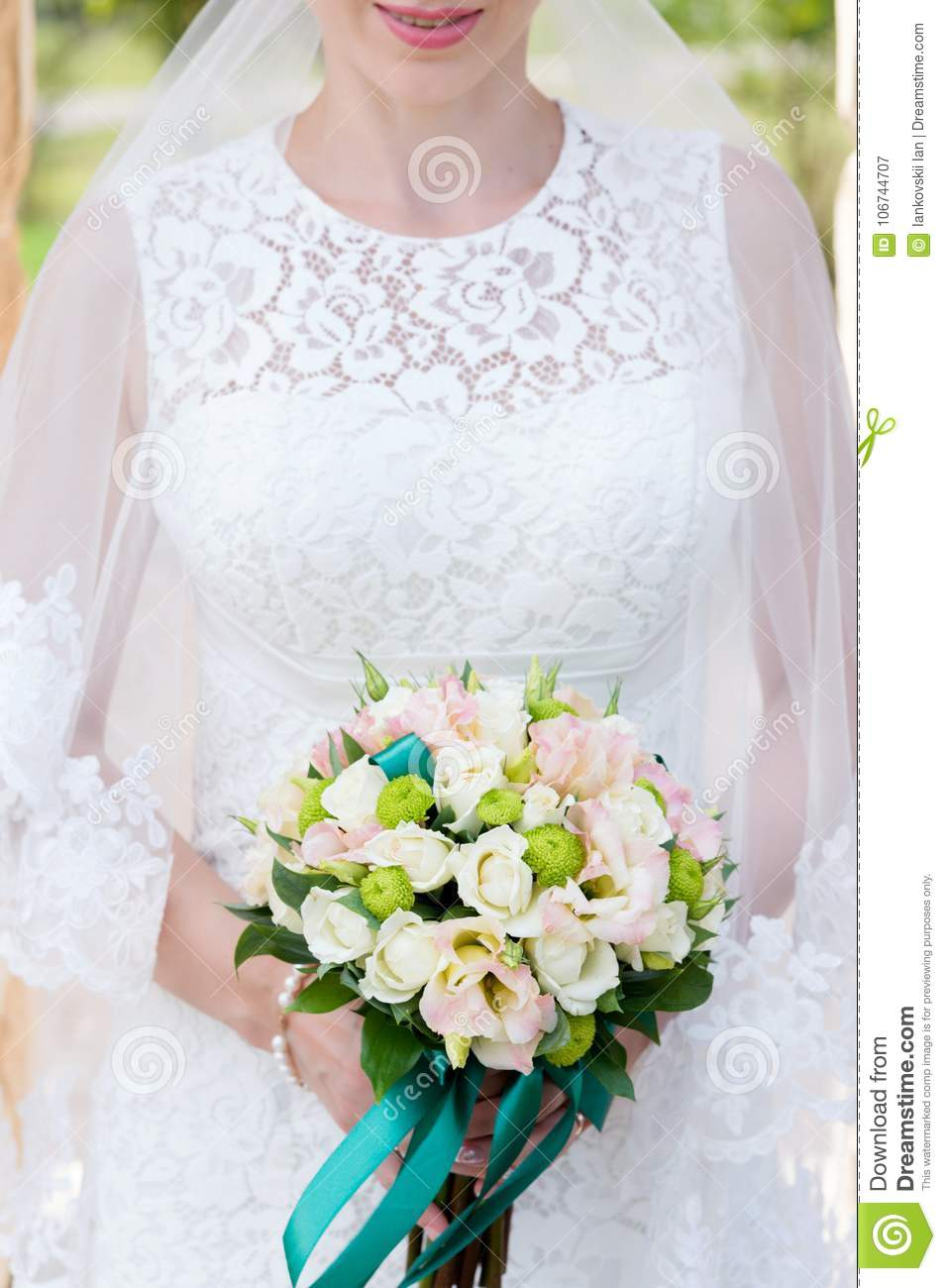Close-up Of A Bridal Bouquet Near The Bride In Her Arms. Chin Chest ...