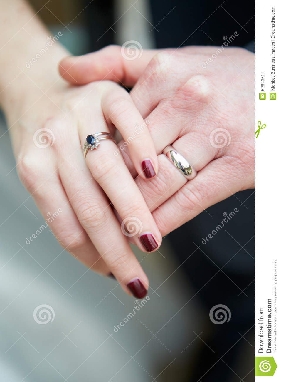 Close Up Of Bride And Groom Wearing Wedding Rings Stock Image ...