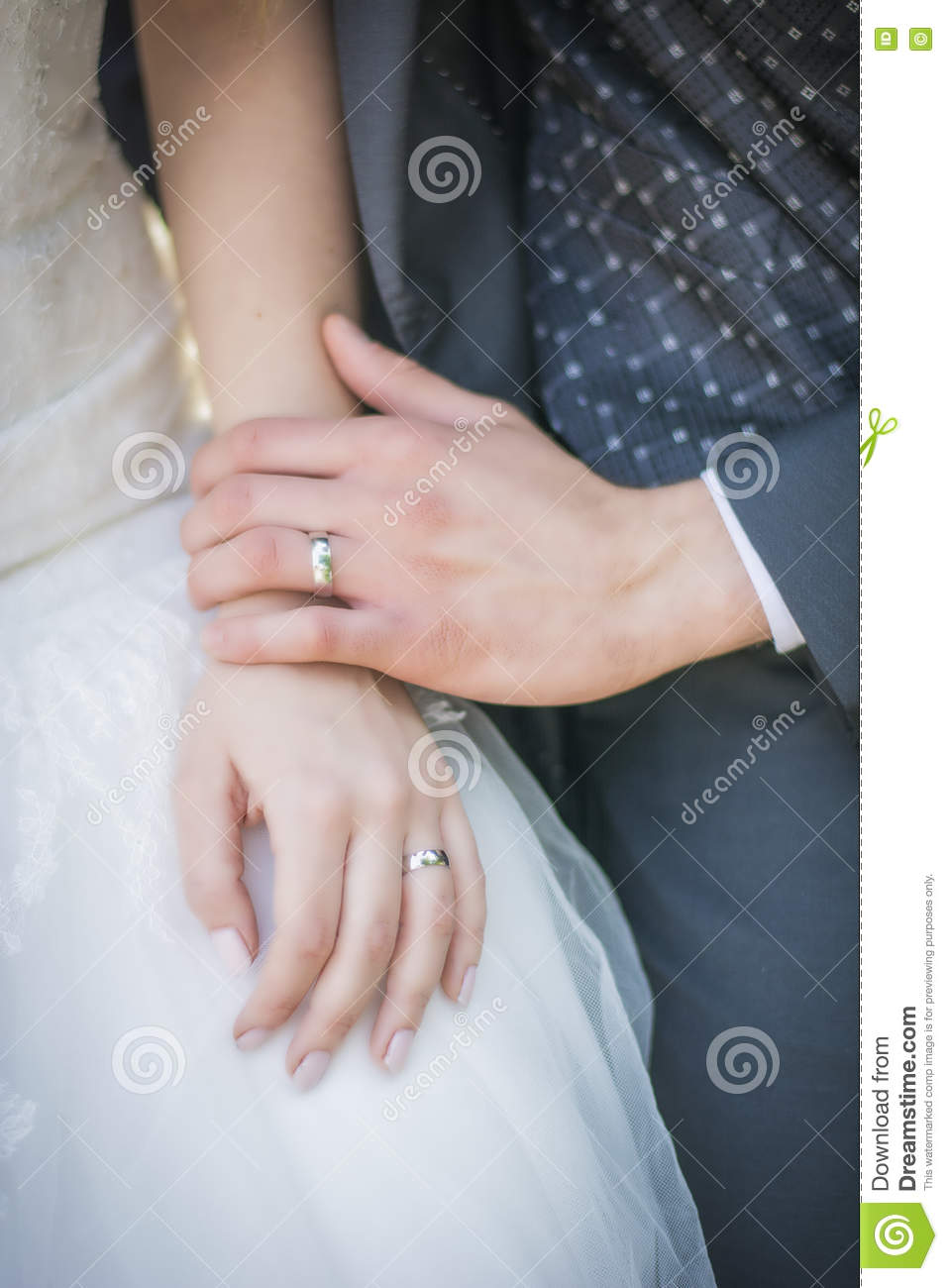 Close-up Of Bridegroom Wearing Wedding Ring On Bride\'s Finger Stock ...