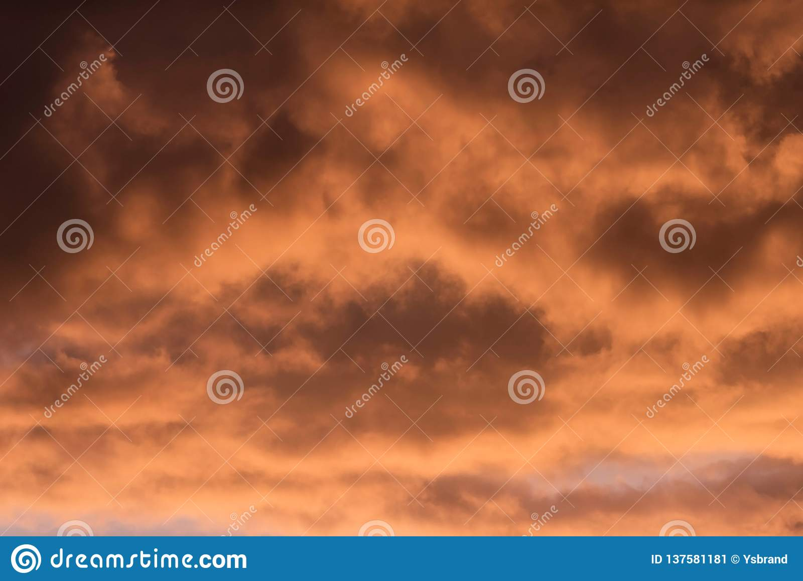 Close-up of brown orange coloured clouds.