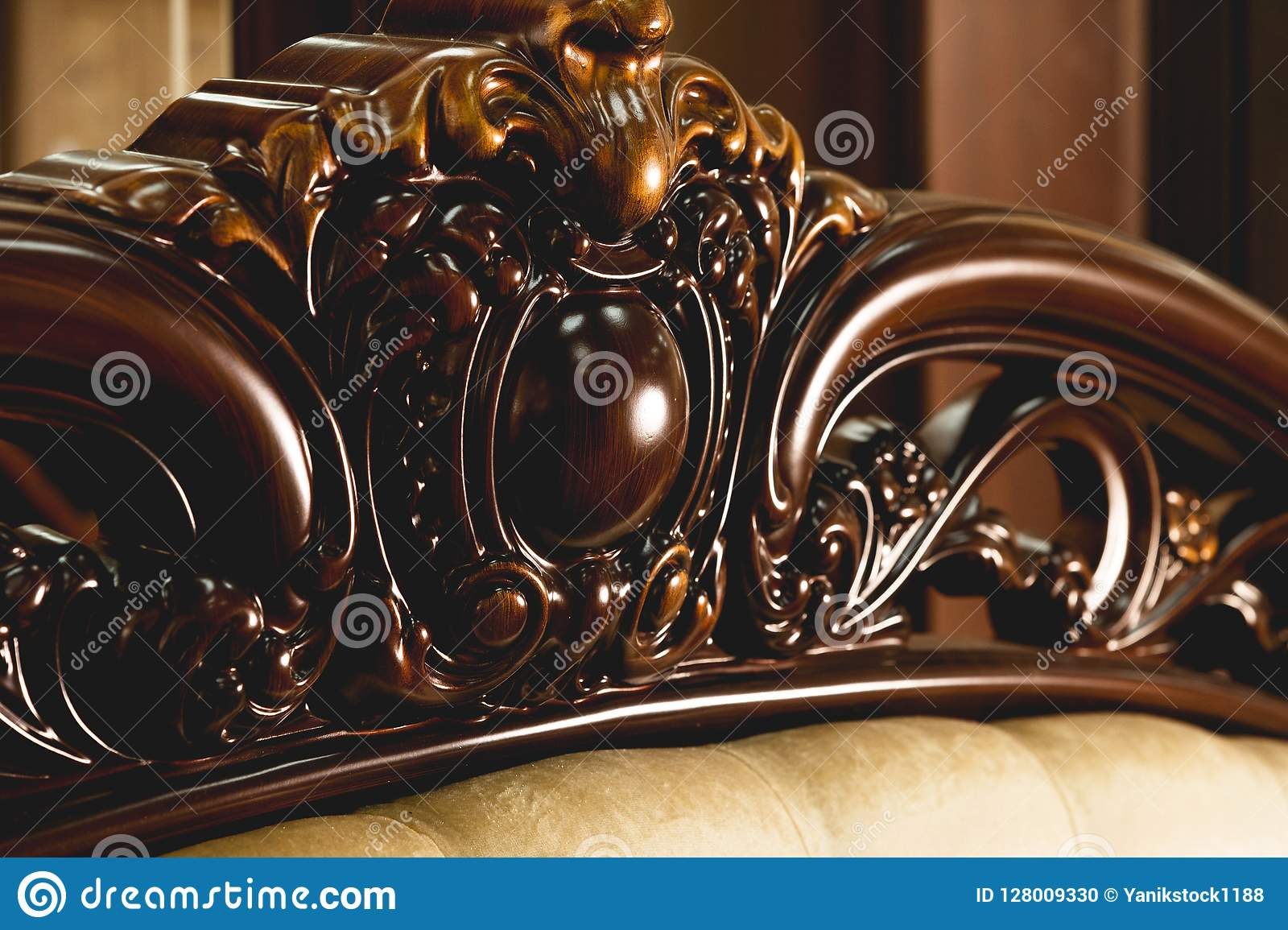 Close-up Brown wooden carved patterns headboard of a double bed. Retro Stylish Bedroom
