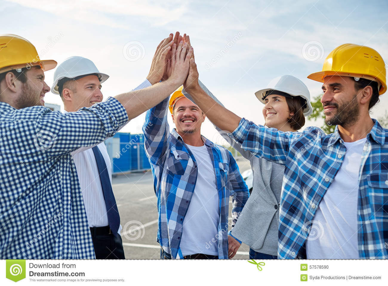 Close Up Of Builders In Hardhats Making High Five Stock ...