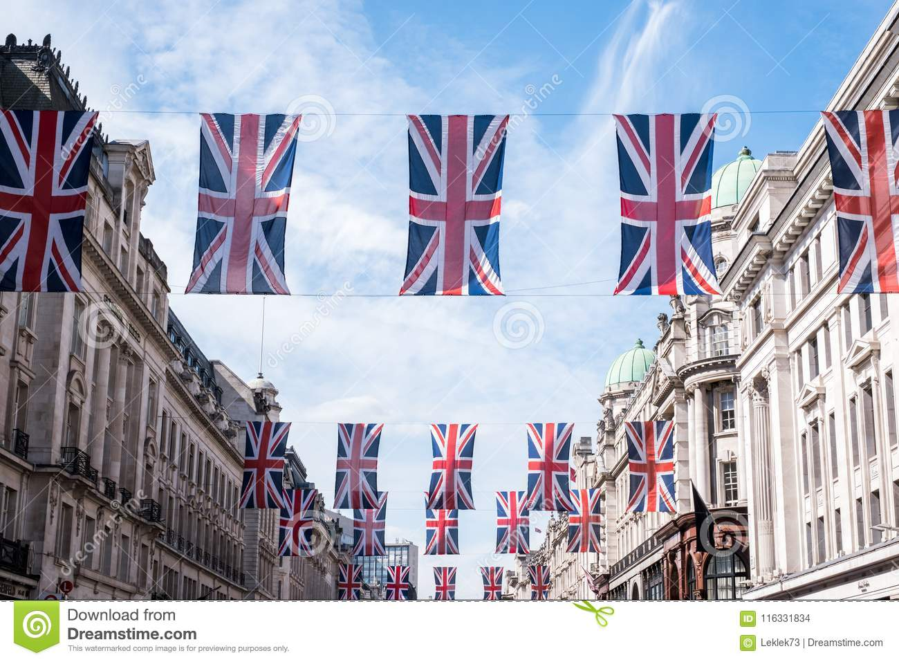 Close up of buildings on Regent Street London with row of British flags to celebrate the wedding of Prince Harry to Meghan Markle