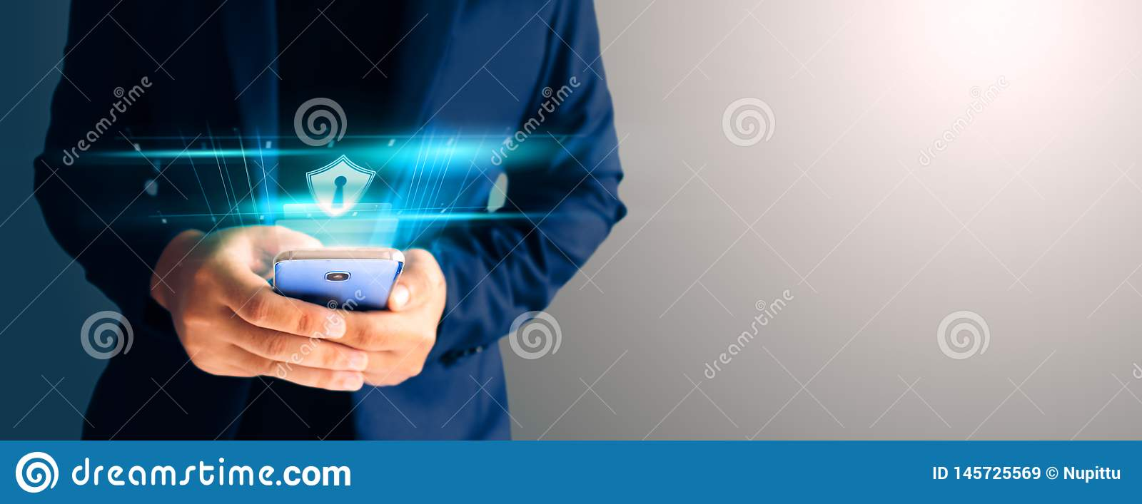 Close up business man formal blue suit Use hold smart phone in the dark.