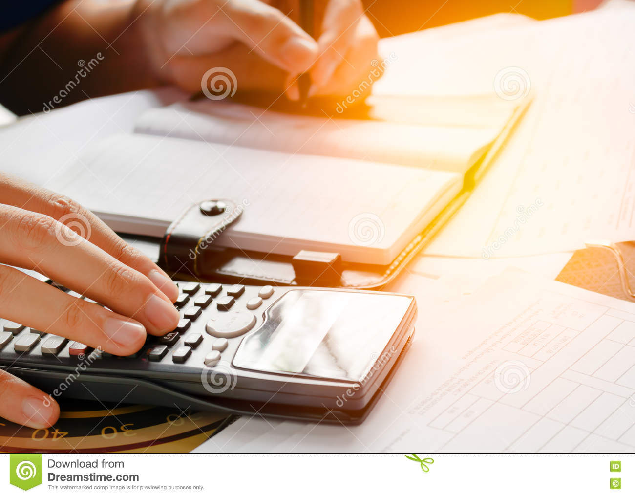 Close up, business man or lawyer accountant working on accounts using a calculator and writing on documents,