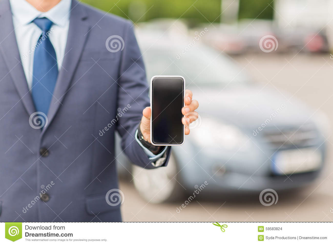 close up of business man with smartphone and car royalty free stock photo. Black Bedroom Furniture Sets. Home Design Ideas
