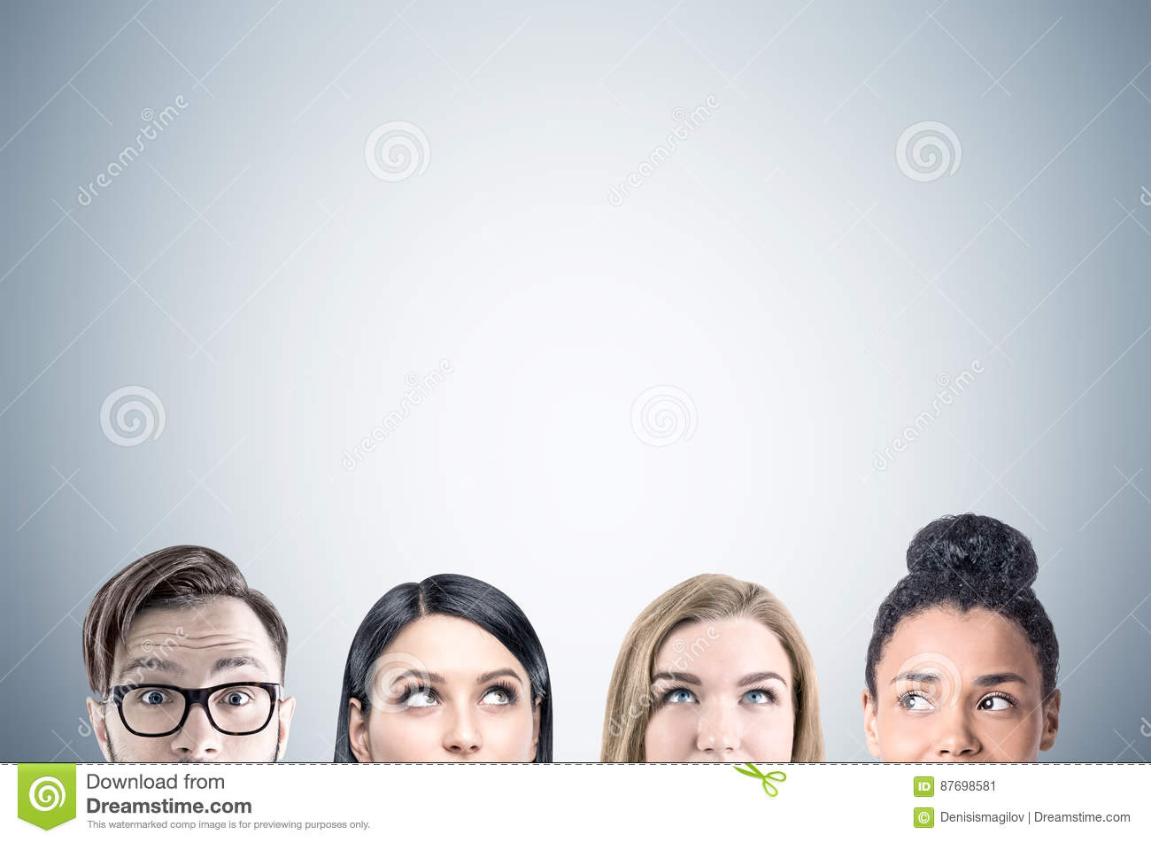 Close up of business team faces, gray
