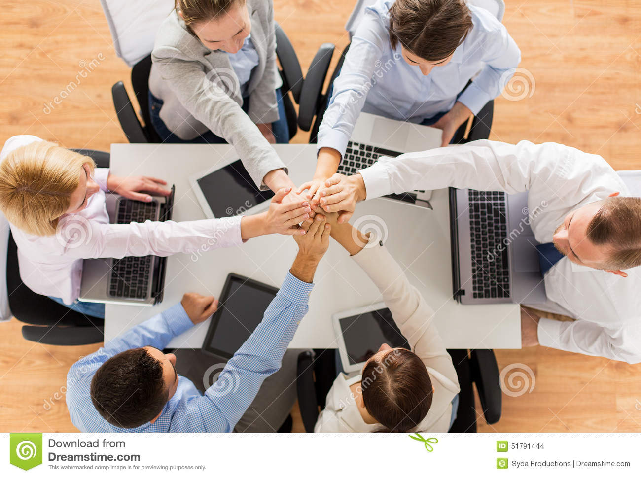 Technology Management Image: Close Up Of Business Team With Hands On Top Stock Photo