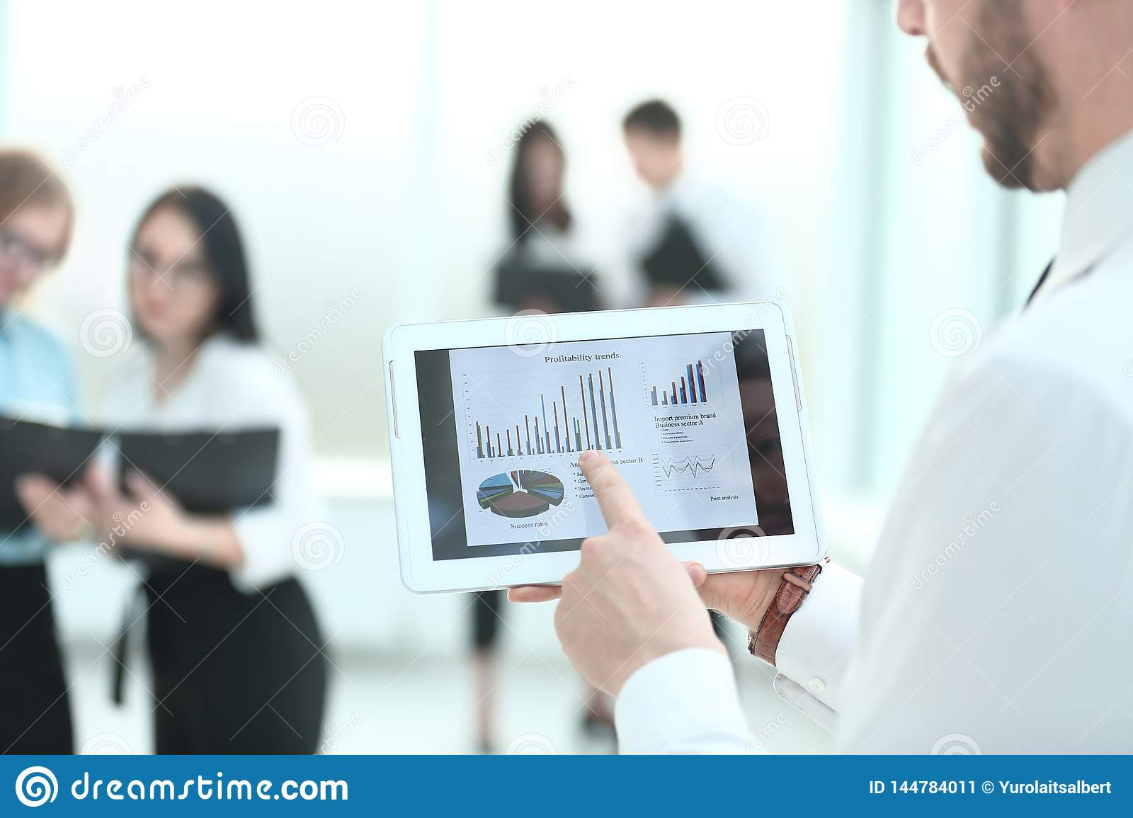 Close up.businessman with digital tablet, analyzes with financial charts