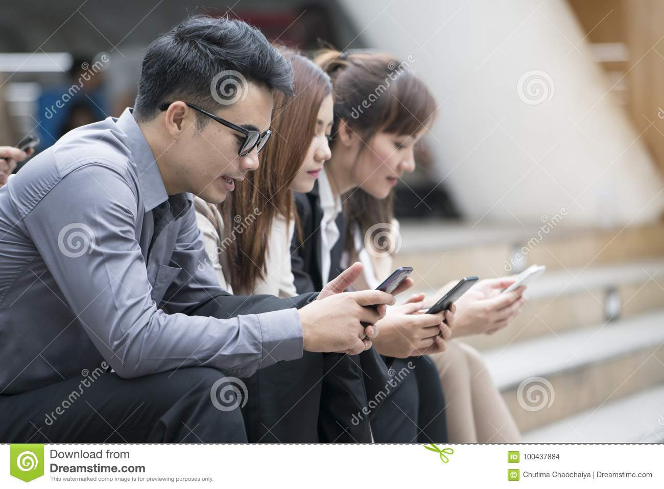 Close up of businessmen and businesswomen using smartphone