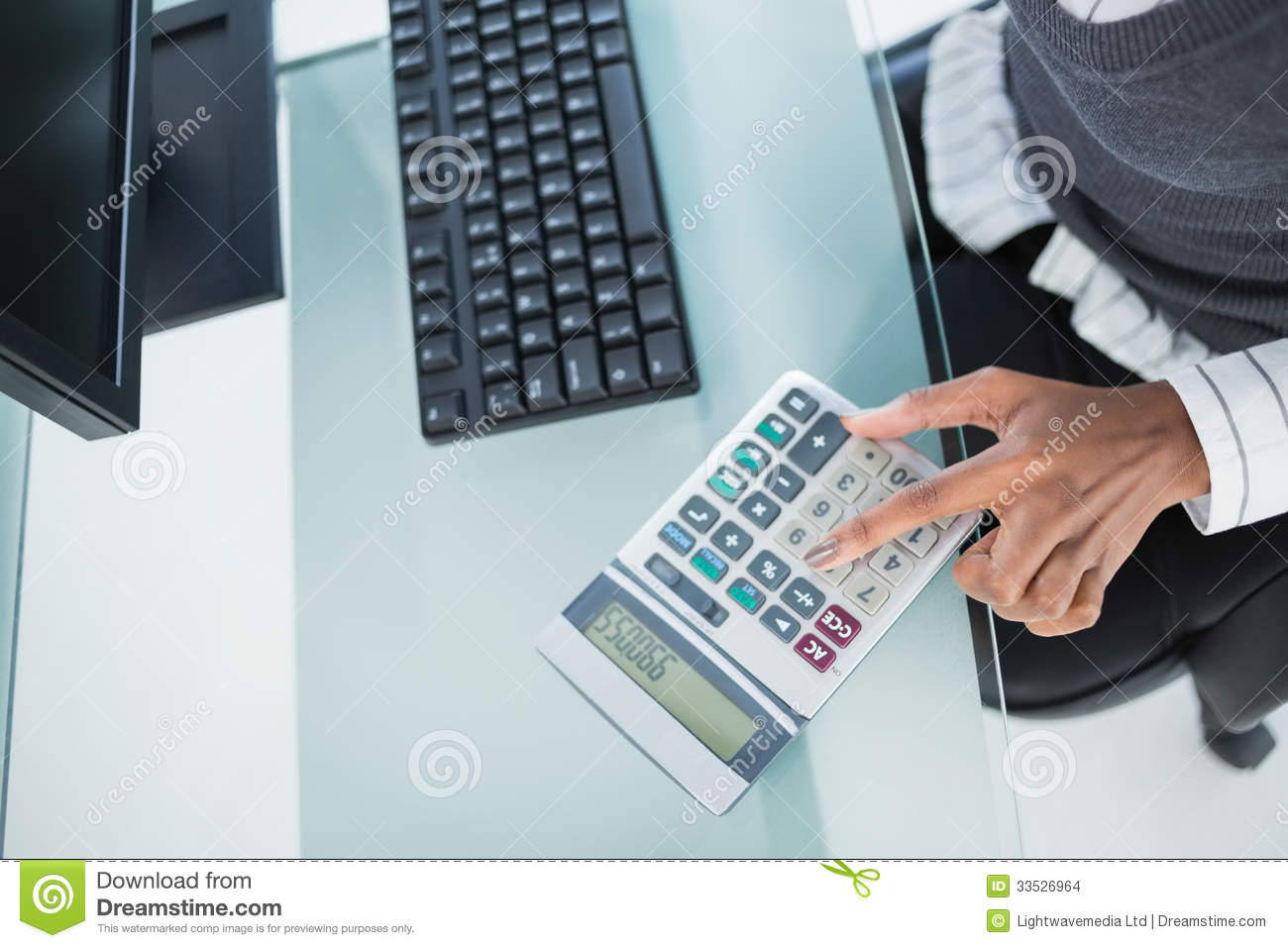 Close Up On Businesswoman Using Calculator Stock Images