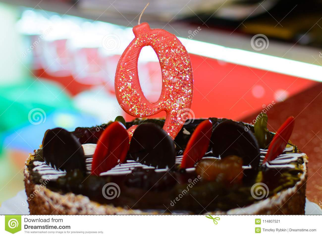 A Close Up Cake With The Number 9 On Birthday Decorated Sweets