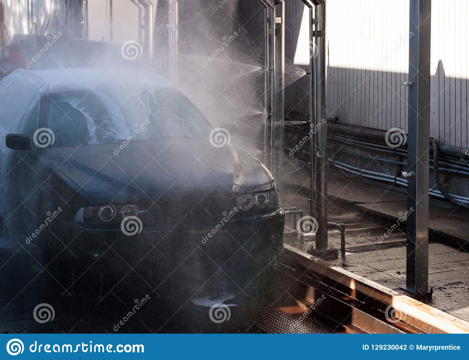 Spray Car Wash >> Close Up Of Car Being Spray Washed In An Automated Car Wash