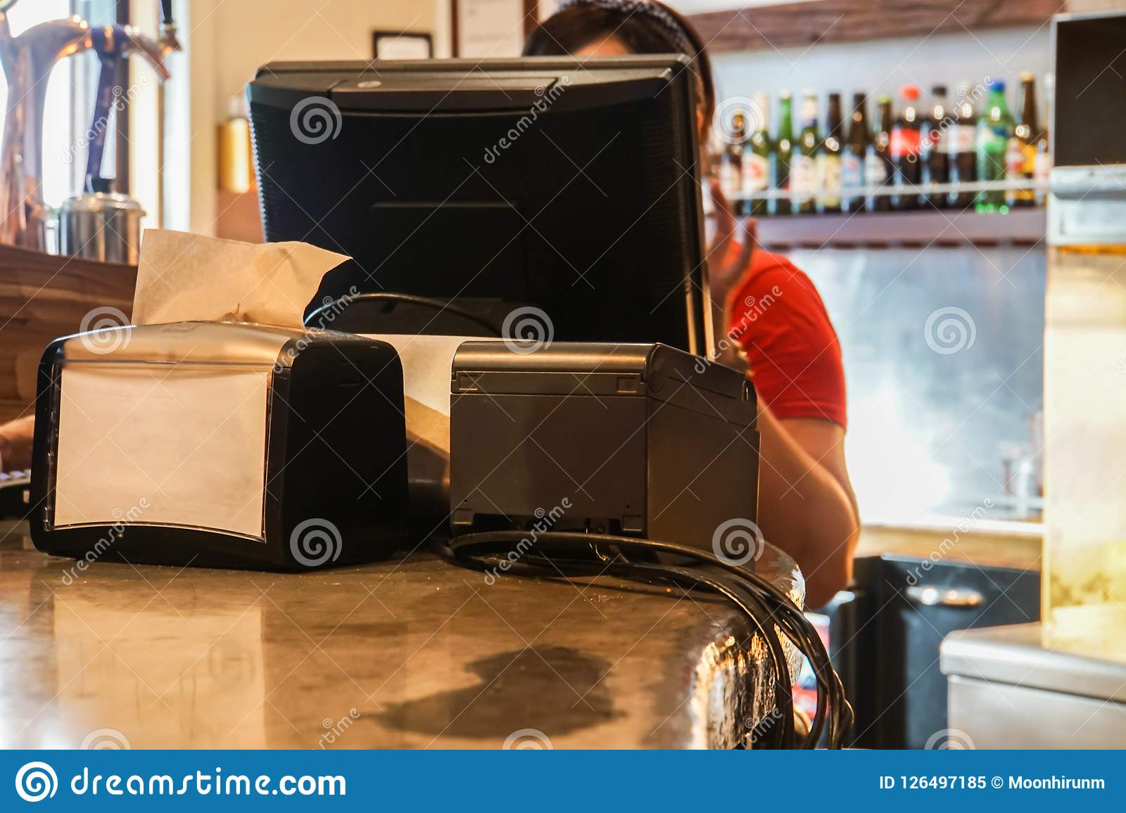 Cashier counter with computer for billing in fast food restaurant