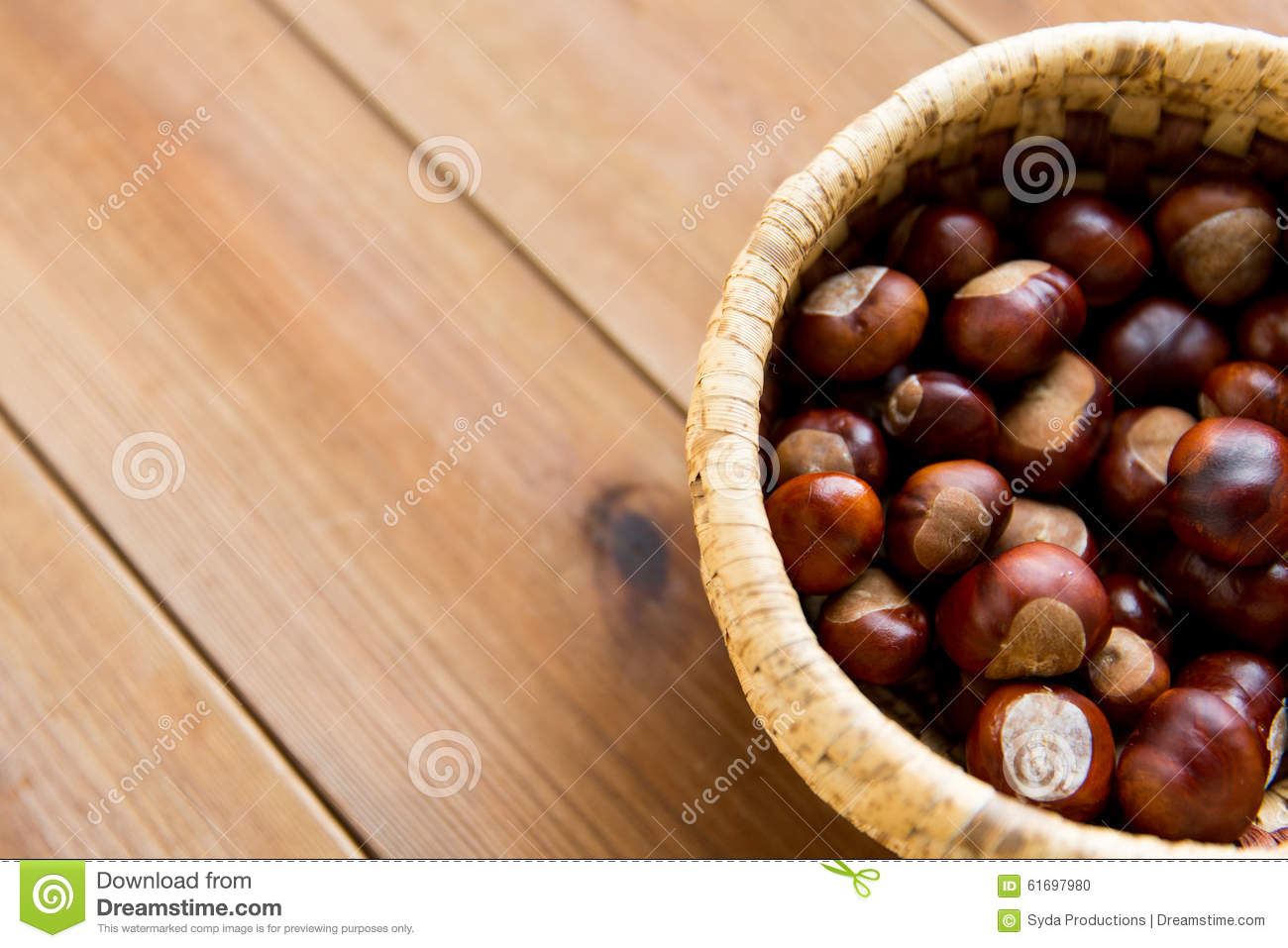 Close up of chestnut on wooden table stock image
