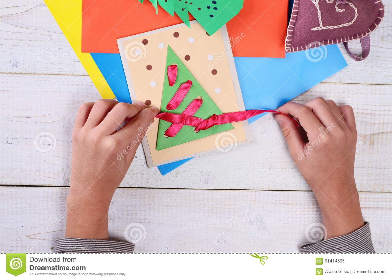 Close up on child 39 s hands making christmas tree from - Colored paper art projects ...
