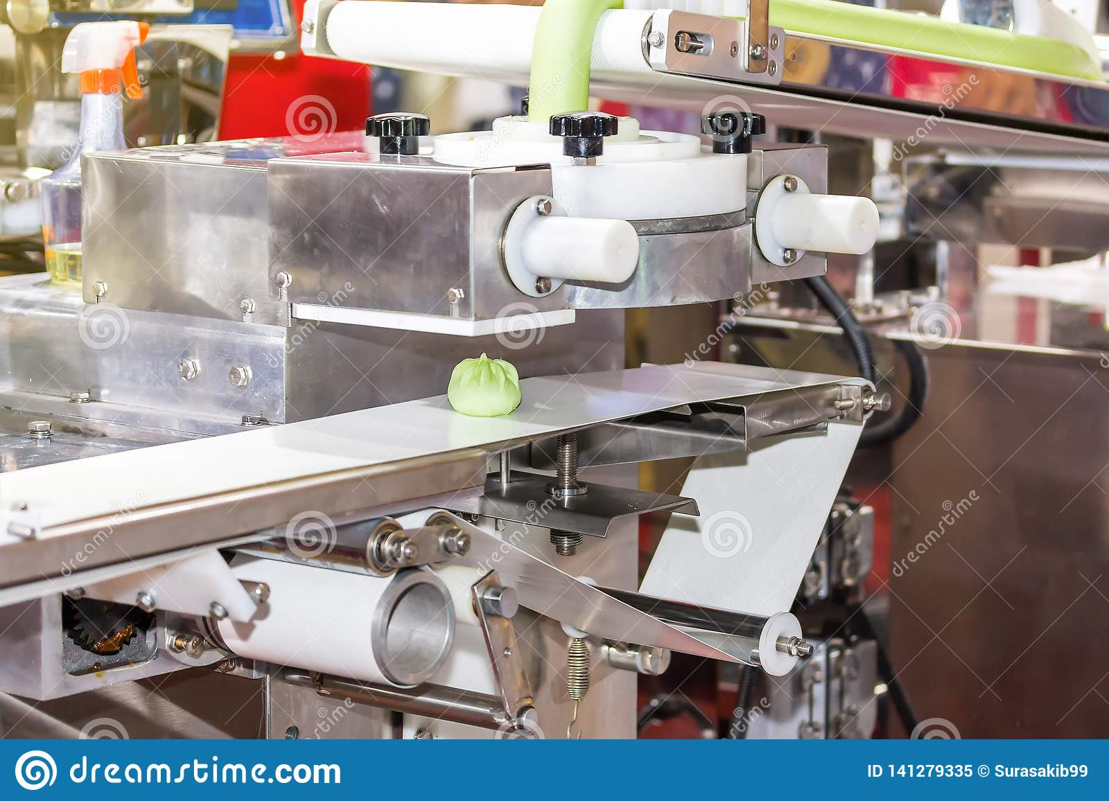 Close up chinese or asian food steamed stuffed buns on automatic belt conveyor of food making machine in production line for high