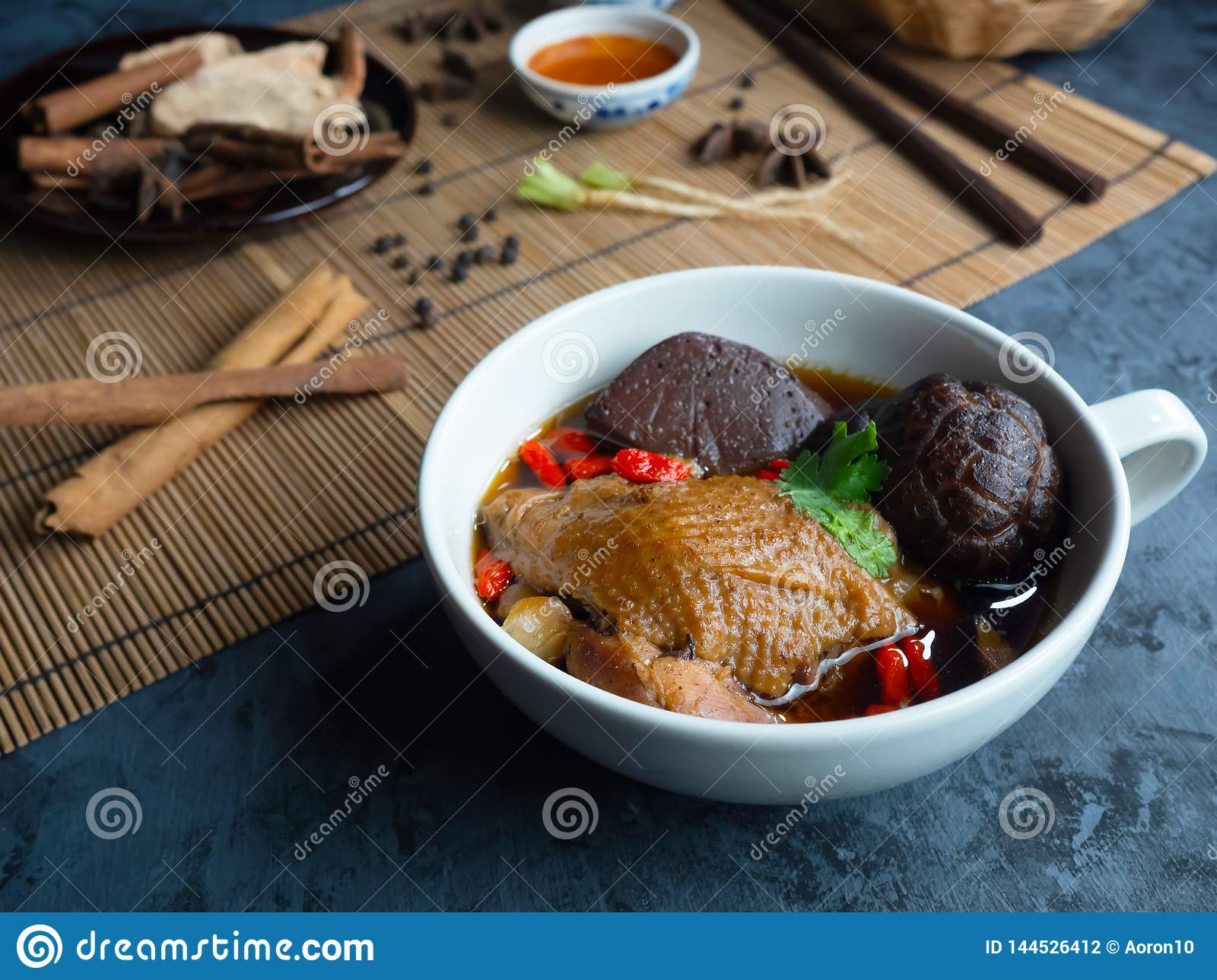 Close Up Of Chinese Chicken Soup In A White Cup Decorated With