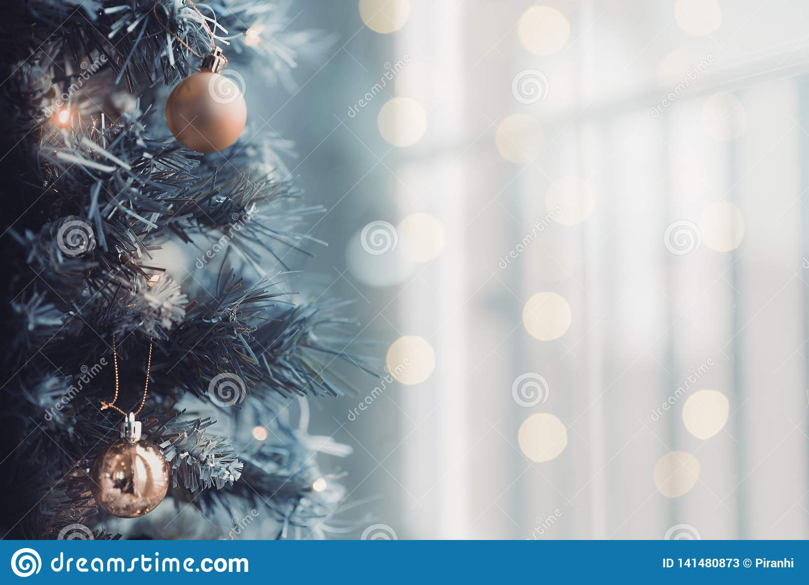Close up of Christmas tree with a bright bokeh background