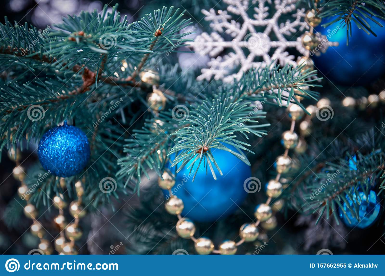 Close Up Of A Christmas Tree With Rose Gold And Turquoise Decorations Balls Snowflakes Bows Beads On A Blurry Background Stock Image Image Of Bokeh Decorations 157662955