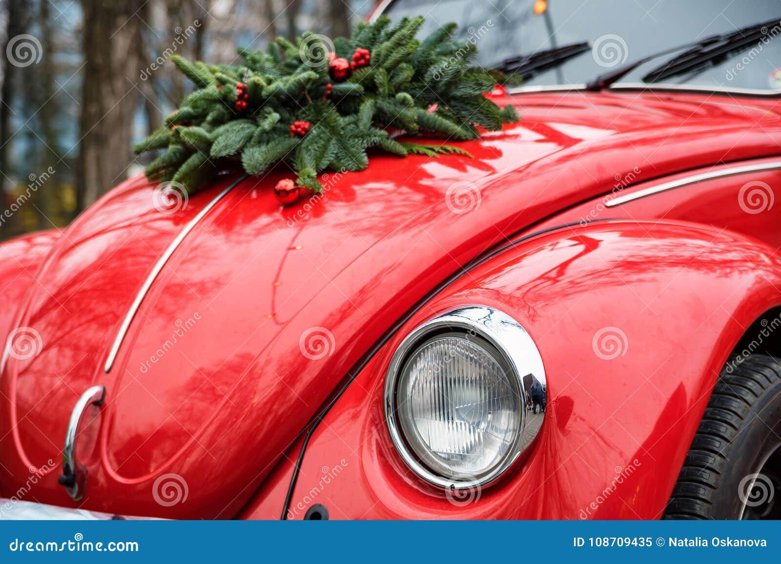 Close up Christmas wreath on red retro car