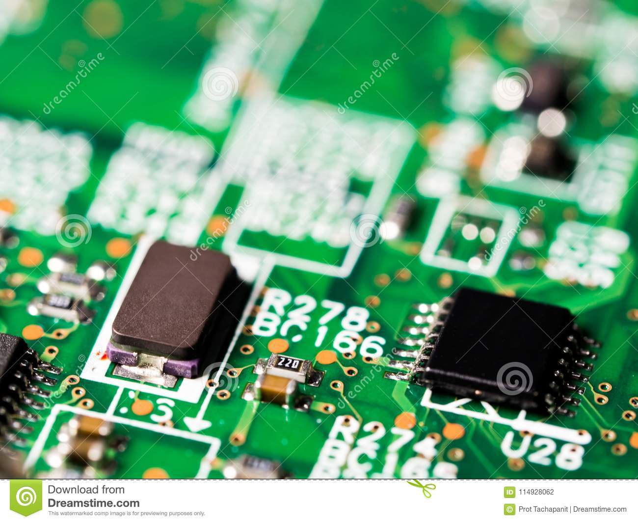 Close Up Of Circuit Board With Integrated Circuits Resistors And Download Capacitors Stock Photo