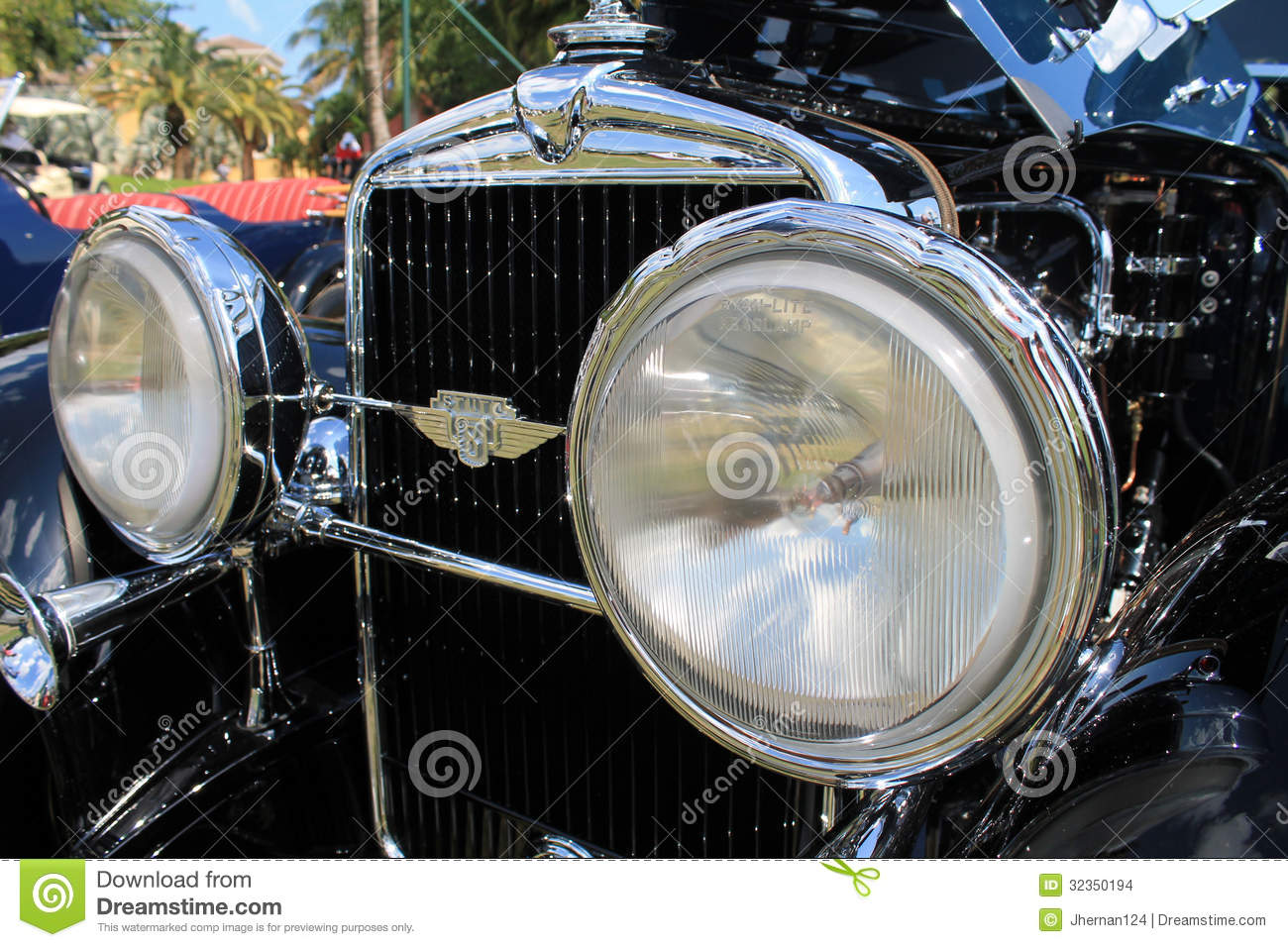 Antique Automobile Headlamps : Close up classic car s stylish headlamps and grill