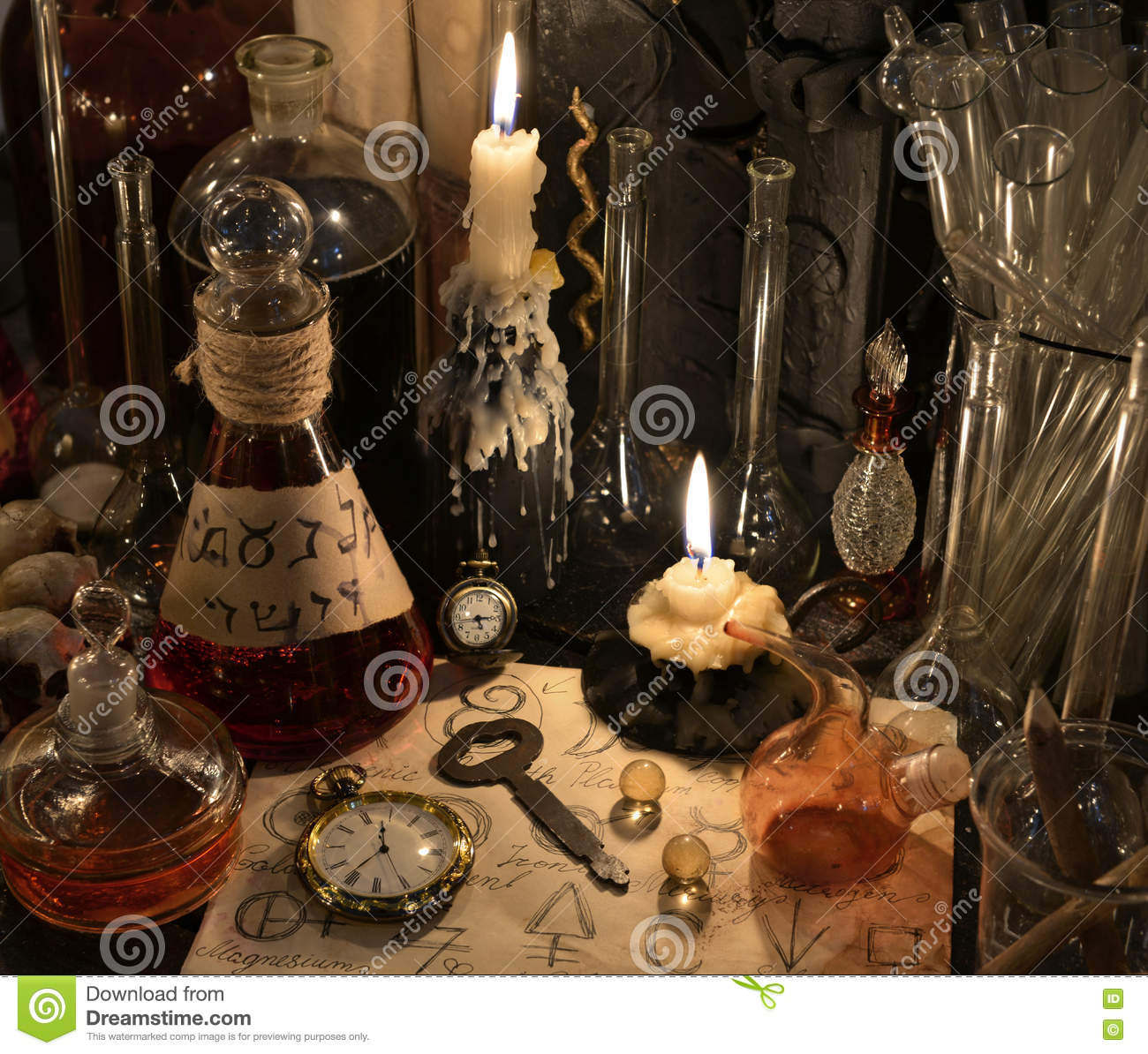 Close Up With Clock Key Candle Bottles And Magic Objects Stock