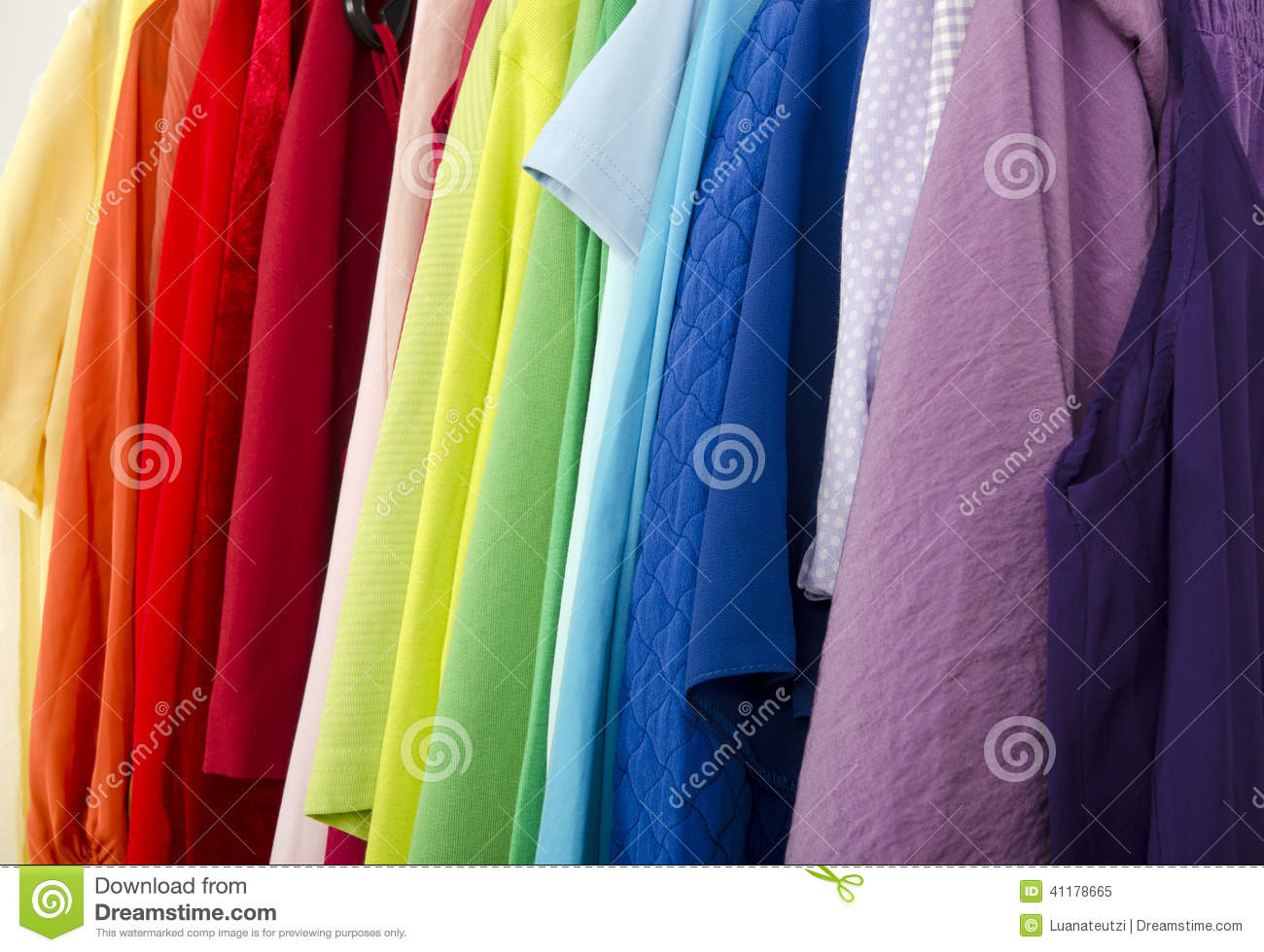 close up on color coordinated clothes on hangers in a store royalty free stock photo. Black Bedroom Furniture Sets. Home Design Ideas