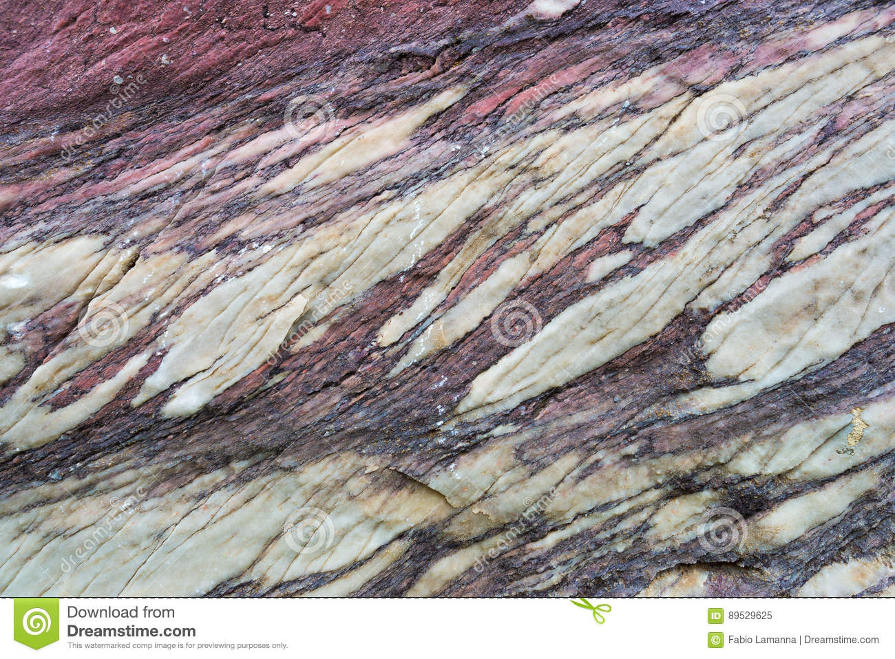 Close up of colorful rock surface, natural background, pattern and texture. Metamorphic white quartzite folded and fractured toget