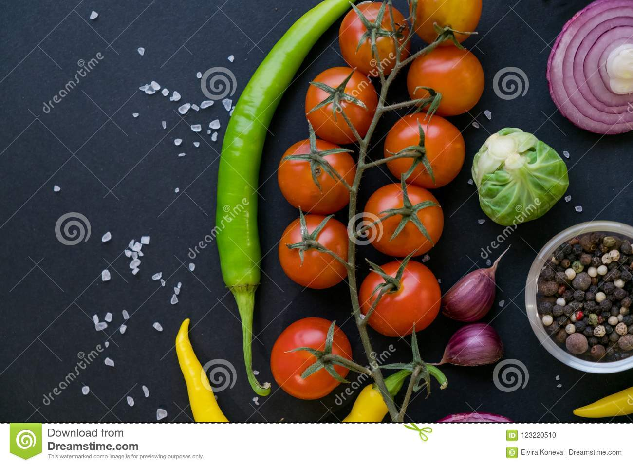 Traditional Latin American mexican Tomato sauce salsa, chilean chancho en piedra in stone mortar and ingredients