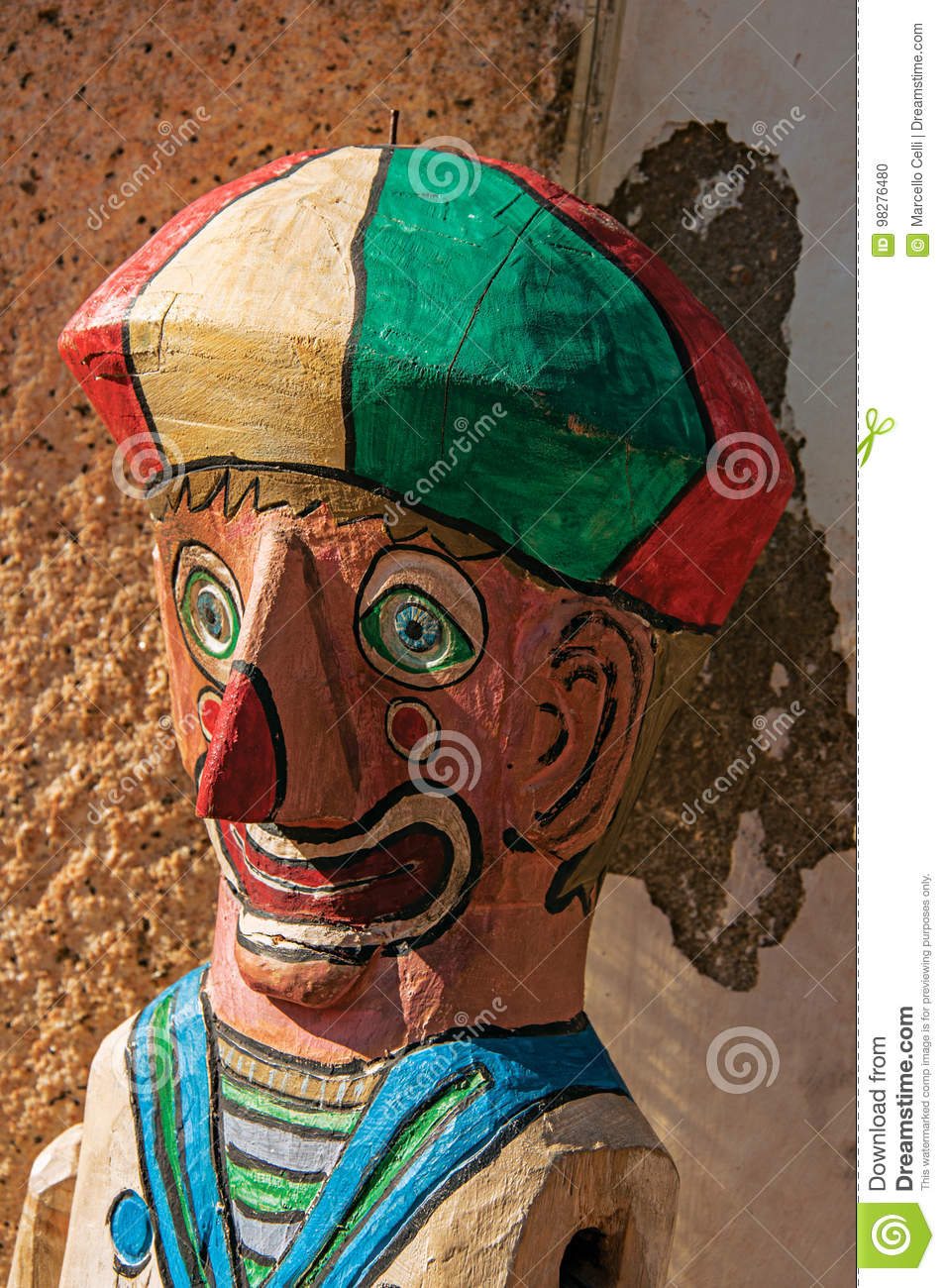 Close-up of colorful wooden puppet reminding a clown in Paraty.