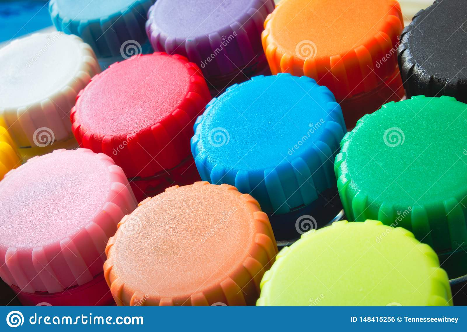 Close-up of colourful lids of kids` poster paint pots